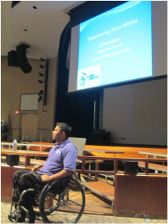 Global Abilities Foundation Executive Director makes a disability awareness presentation in front of a large audience