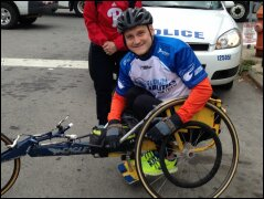 A Global Abilities wheelchair racing athlete smiles for the camera before the Philadelphia Broad Street Run